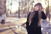 Girl with long blond hair  outside — Stock Photo