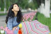 Brunette woman with colorful umbrella — Stock Photo