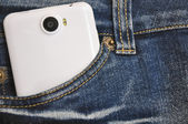 Phone is in the pocket of jeans. — Stockfoto