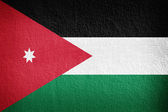 The Jordanian flag painted on grunge wall  — Stock Photo