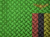 Zambia flag on grunge wall — Stock Photo