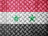 Syria flag on grunge wall — Stock Photo