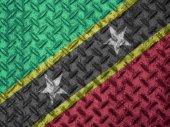 Saint Kitts and Nevis flag on grunge wall — Stock Photo