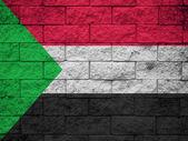 Bandeira do Sudão sobre a textura da parede — Fotografia Stock