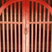 Red door is locked — Stock Photo
