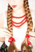 A young beautiful woman with long blonde hair tresses wearing a Polish folk costume — Stock Photo