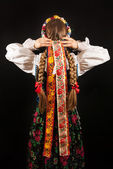 A young beautiful woman wearing a traditional Polish folk costume — Stok fotoğraf