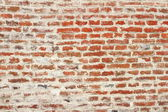 Weathered red brick wall — Stock Photo