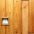 Old electric switch on wooden wall — Stock Photo #58163109