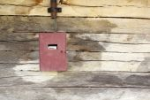 Electric panel on wooden building — Stock Photo
