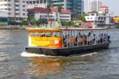 BANGKOK,THAILAND DEC 12: Passenger boat on the Chao Phraya river — Stock Photo