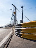 The side of a road with metal barriers. — Stock Photo
