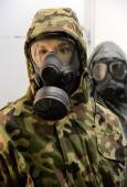 Soldiers in gas masks — Stock Photo