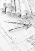 Rolls of architecture blueprints and house plans — Stock Photo