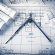 Rolls of architecture blueprints and house plans — Stock Photo #75836353