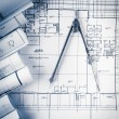 Rolls of architecture blueprints and house plans — Stock Photo #75836365