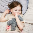 Little girl in bed playing — Stock Photo #66212167