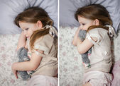 Little girl in bed playing with a kitten — Stock Photo