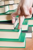 Hand on the books. — Stock Photo