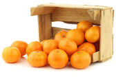 Bunch of fresh tangerines in a wooden box — Stock Photo