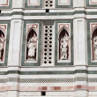 Four statues in niches on Bell Tower on Piazza del Duomo in Florence in Italy — Stock Photo #56885369