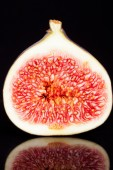Half of  sectioned fresh fig on black background-macro — Stock Photo