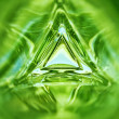 Abstract image of the inside of a triangle glass bottle emerald green color background — Stock Photo #71643153