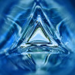 Abstract image of the inside of a triangle glass bottle blue color background — Stock Photo #71643285