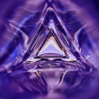 Abstract image of the inside of a triangle glass bottle purple color background — Stock Photo #71645165