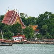 Temple beside sea with boat and tree . — Stock Photo #58629421