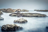 Pebble rocks on beach die Oysterl ,Long exposure technic . — Stock Photo