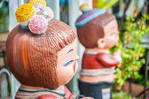 Thai style sculpture doll girl and boy happy — Stock Photo