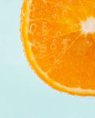 Orange slice and water droplets — Stock Photo