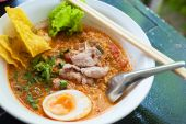Pork noodle tom yum, condensed water egg — Stock Photo