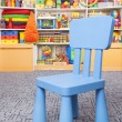 Chair and shelf with toys — Stock Photo #62049819