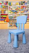 Chair and shelf with toys — Stock Photo