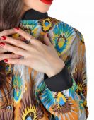 Fragment of female attire. Variegated blouse. — Stock Photo
