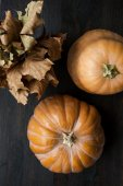 Large pumpkins on a wooden table, decor — Stock Photo