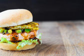 Homemade fish burger with salmon, avocado and pineapple.Close up — Stock Photo