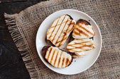 Crostini with fried cheese on the grill — Stock Photo