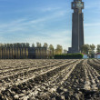 Plowed land fronts Tallest World War I memorial in Belgium. — Stock Photo #57394573