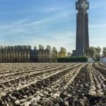 Plowed land fronts Tallest World War I memorial in Belgium. — Stock Photo #57394573