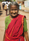 Old Tamil woman with red sari. — Stock Photo