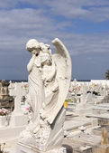 Angel in sorrow on cemetery. — Stock Photo
