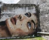 Graffiti of blue eyed woman face. — Stock Photo