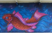 Graffiti of pink fish in blue water. — Stock Photo