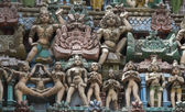 Statues of naked people on Sarangapani temple Gopuram. — Stock Photo