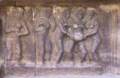 Mural sculpture of standing-up birthing scene. — Stock Photo