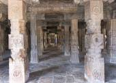 Look through pillared Mandapam straight into Mariamman shrine. — Stock Photo