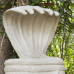 Shrine with large, white five-headed cobra statue of Shesha. — Stock Photo #73127431